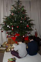 kids opening Christmas presents photo